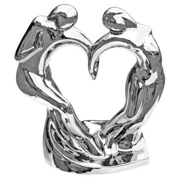 Dancing couple with heart ornament