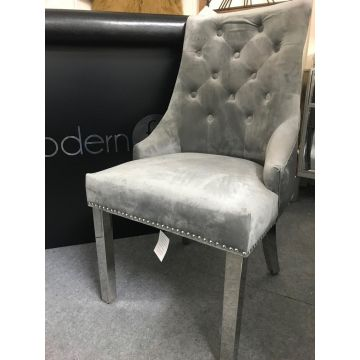 Light grey velvet chair with door knocker pull handle and chrome leg
