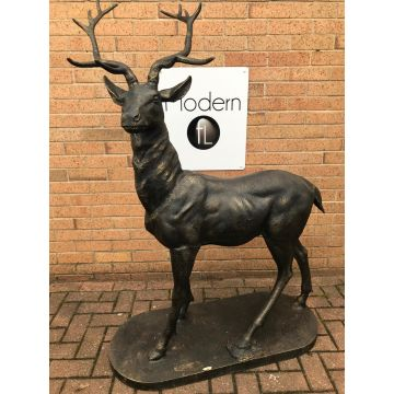 Large standing stag garden statue facing right