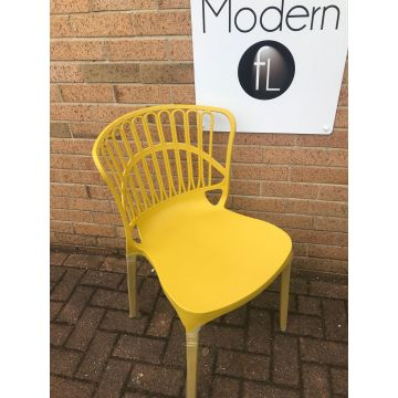 Stack-able contemporary yellow plastic outdoor or indoor dining seat