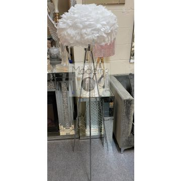 Contemporary chrome tripod floor lamp with white feather shade