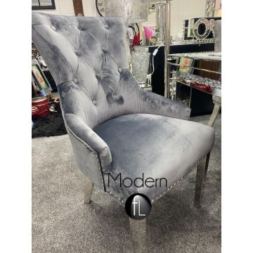 Dark grey velvet dining chair with knocker ring pull
